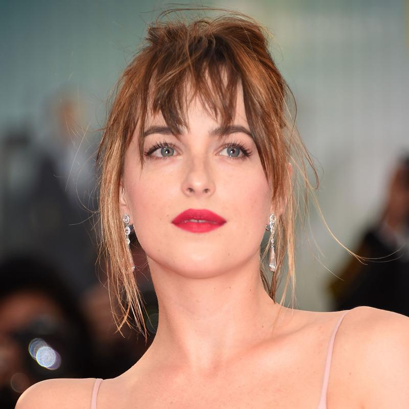 "<p>For the premiere of ""Black Mass,"" Brown created a slightly messy French twist for Johnson's red carpet festival debut. Her bangs have that just-went-to-a-spin-class-but-didn't-try-that-hard-so-my-hair-still-looks-good vibe (in the best way possible). </p>"