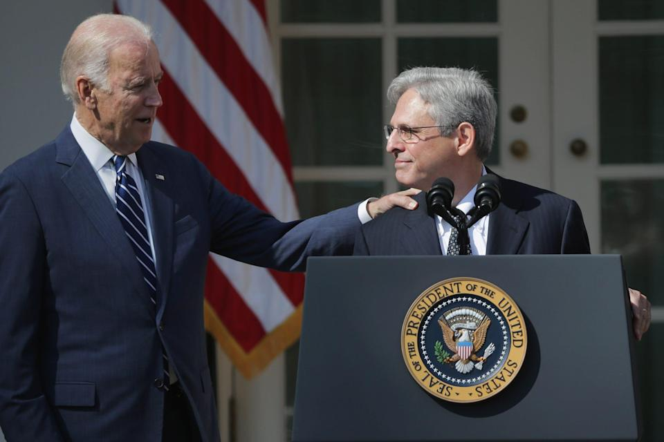 President-elect Joe Biden has reportedly chosen federal appeals court judge Merrick Garland as his attorney general.  Seen here, then Vice President Joe Biden congratulates Judge Merrick Garland after he was nominated by President Barack Obama to the Supreme Court in the Rose Garden at the White House, March 16, 2016 in Washington, DC.