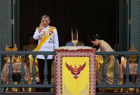 Thailand's newly crowned King Maha Vajiralongkorn is seen at the balcony of Suddhaisavarya Prasad Hall at the Grand Palace where he grants a public audience to receive the good wishes of the people in Bangkok, Thailand May 6, 2019.REUTERS/Jorge Silva