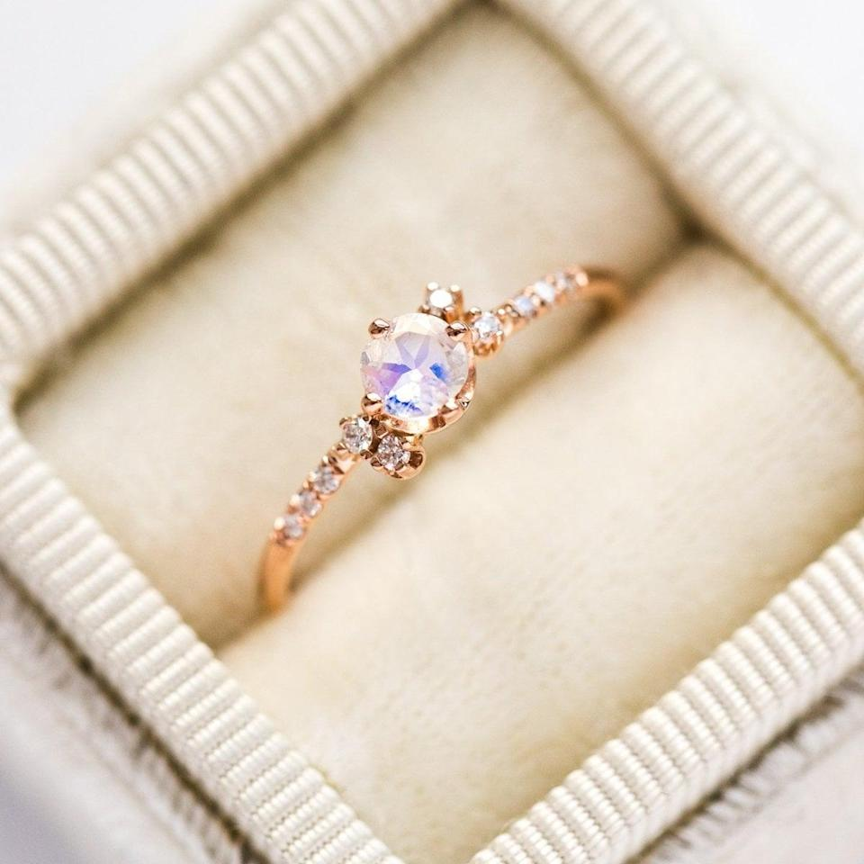 """<p>The asymmetrical diamond clusters on the <a href=""""https://www.popsugar.com/buy/14k-Diamond-Moonstone-Cluster-Ring-531203?p_name=14k%20Diamond%20Moonstone%20Cluster%20Ring&retailer=localeclectic.com&pid=531203&price=568&evar1=fab%3Aus&evar9=44555978&evar98=https%3A%2F%2Fwww.popsugar.com%2Fphoto-gallery%2F44555978%2Fimage%2F47011752%2F14k-Diamond-Moonstone-Cluster-Ring&list1=wedding%2Cjewelry%2Crose%20gold%2Cengagement%20rings&prop13=api&pdata=1"""" rel=""""nofollow noopener"""" class=""""link rapid-noclick-resp"""" target=""""_blank"""" data-ylk=""""slk:14k Diamond Moonstone Cluster Ring"""">14k Diamond Moonstone Cluster Ring</a> ($568) are so pretty. </p>"""