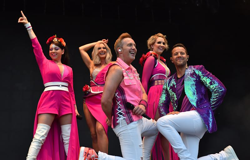"Lisa Scott-Lee, Faye Tozer, Ian ""H"" Watkins, Claire Richards and Lee Latchford-Evans of Steps headline on stage during Day 1 of Kew The Music at Kew Gardens on July 10, 2018 in London, England. (Photo by C Brandon/Redferns)"