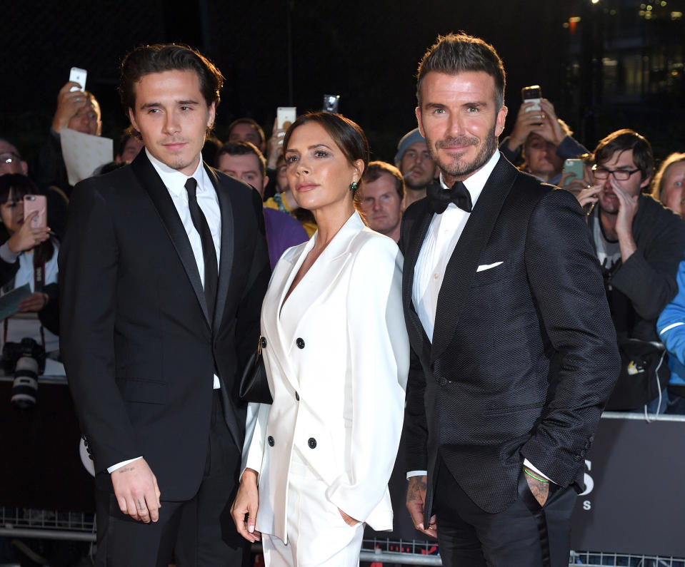 LONDON, ENGLAND - SEPTEMBER 03: Brooklyn Beckham, Victoria Beckham and David Beckham attend the GQ Men Of The Year Awards 2019 at Tate Modern on September 03, 2019 in London, England. (Photo by Karwai Tang/WireImage)