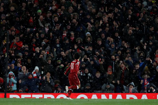 "Soccer Football - Premier League - Liverpool vs Watford - Anfield, Liverpool, Britain - March 17, 2018 Liverpool's Mohamed Salah celebrates scoring their fourth goal and completes his hat-trick Action Images via Reuters/Lee Smith EDITORIAL USE ONLY. No use with unauthorized audio, video, data, fixture lists, club/league logos or ""live"" services. Online in-match use limited to 75 images, no video emulation. No use in betting, games or single club/league/player publications. Please contact your account representative for further details."
