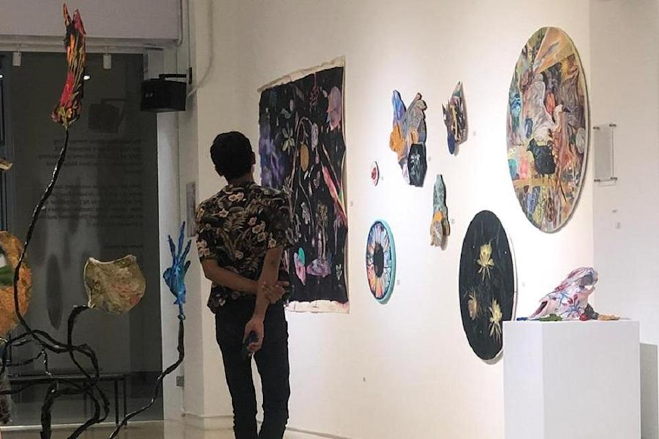 A visitor admiring the art pieces at Zhan Art Space. ― Picture courtesy of Zhan Art Space