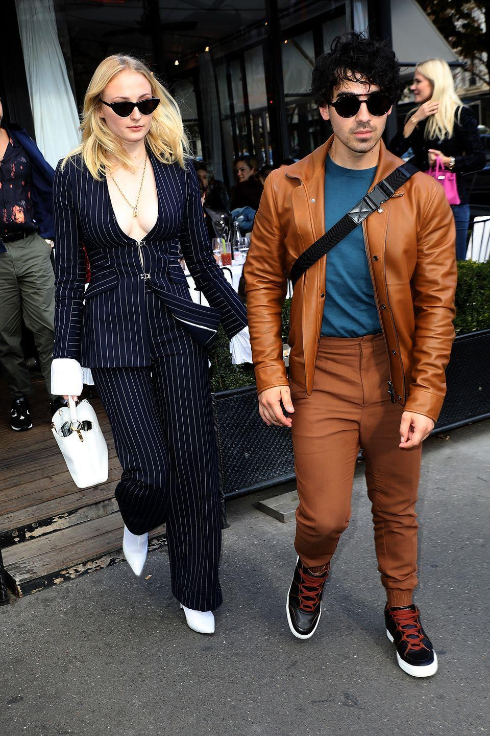 <p>The Paris Fashion Week regulars, at this point, look super cool in shades leaving a restaurant in the French capital.</p>