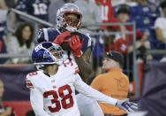 New England Patriots wide receiver Demaryius Thomas, top, catches a touchdown pass over New York Giants defensive back Henre' Toliver (38) in the first half of an NFL preseason football game, Thursday, Aug. 29, 2019, in Foxborough, Mass. (AP Photo/Elise Amendola)
