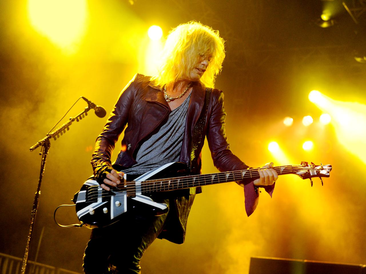 """LOS ANGELES, CA - JUNE 08:  Musician Rick Savage of Def Leppard performs at the after party for the premiere of Warner Bros. Pictures' """"Rock Of Ages"""" at Hollywood and Highland on June 8, 2012 in Los Angeles, California.  (Photo by Kevin Winter/Getty Images)"""