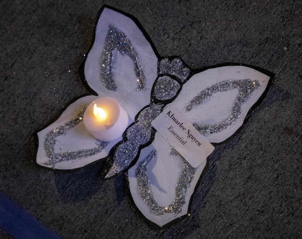 """The name of a person who died from COVID-19 is displayed on butterfly cutout, during a vigil memorializing more than sixty individuals associated with Make the Road New York (MRNY), a support organization for immigrant and working class communities, Thursday May 21, 2020, in Corona Plaza, Queens, N.Y. With support from elected state and city officials, MRNY has launched a campaign called #Recovery4All, demanding Governor Cuomo and Mayor de Blasio create """"a $3.5 billion Excluded Workers' Fund, cancel rent, and release at risk people from prisons and detention centers"""" to address disparities from the pandemic in Queens. (AP Photo/Bebeto Matthews)"""