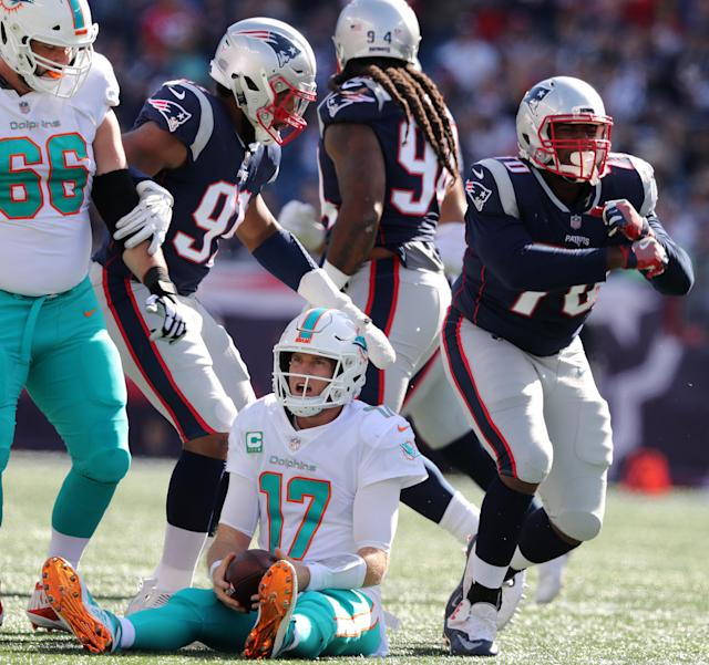 <p>Dolphins quarterback Ryan Tannehill is dejected after Patriots Adam Butler (right) sacked him in the third quarter. New England Patriots hosted the Miami Dolphins at Gillette Stadium in Foxborough, MA on Sept. 30, 2018. (Photo by Jim Davis/The Boston Globe via Getty Images) </p>