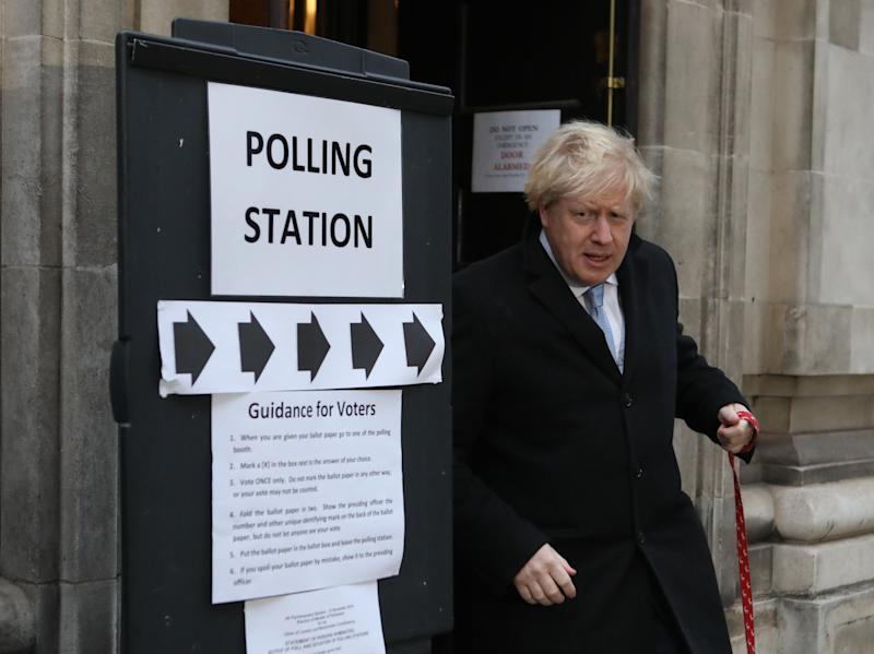 Prime Minister Boris Johnson leaves the polling station with his dog Dilyn after casting his vote in the 2019 General Election at Methodist Central Hall, London.