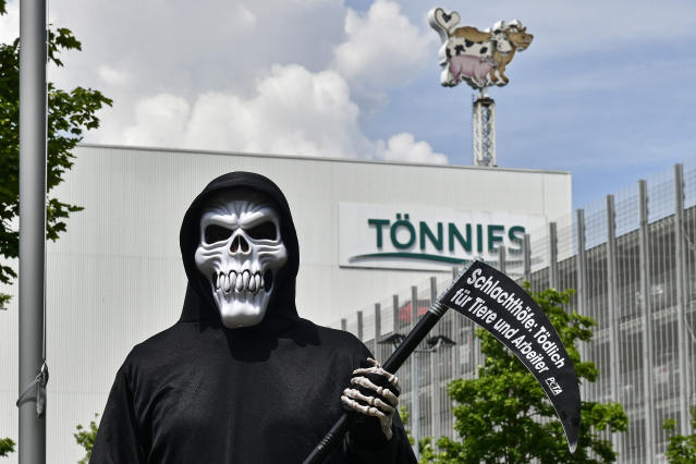 A protester outside an abattoir in Germany run by Toennies. (AP)