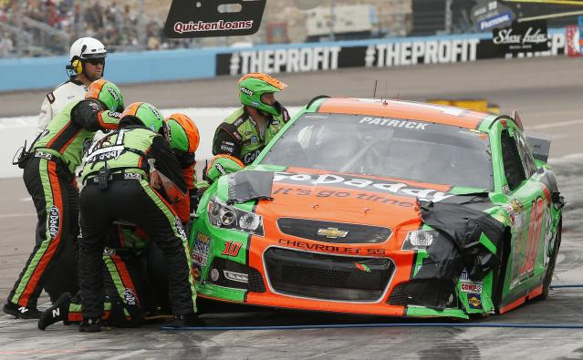 Danica Patrick makes a pit stop during the NASCAR Sprint Cup Series auto race Sunday, March 2, 2014, in Avondale, Ariz. (AP Photo/Ross D. Franklin)