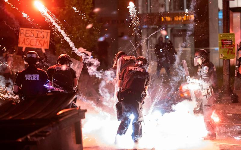 A firecracker thrown by protesters - Andrew Caballero/AFP