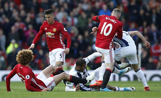 <p>West Bromwich Albion's Salomon Rondon in action with Manchester United's Marcos Rojo, Marouane Fellaini and Wayne Rooney </p>