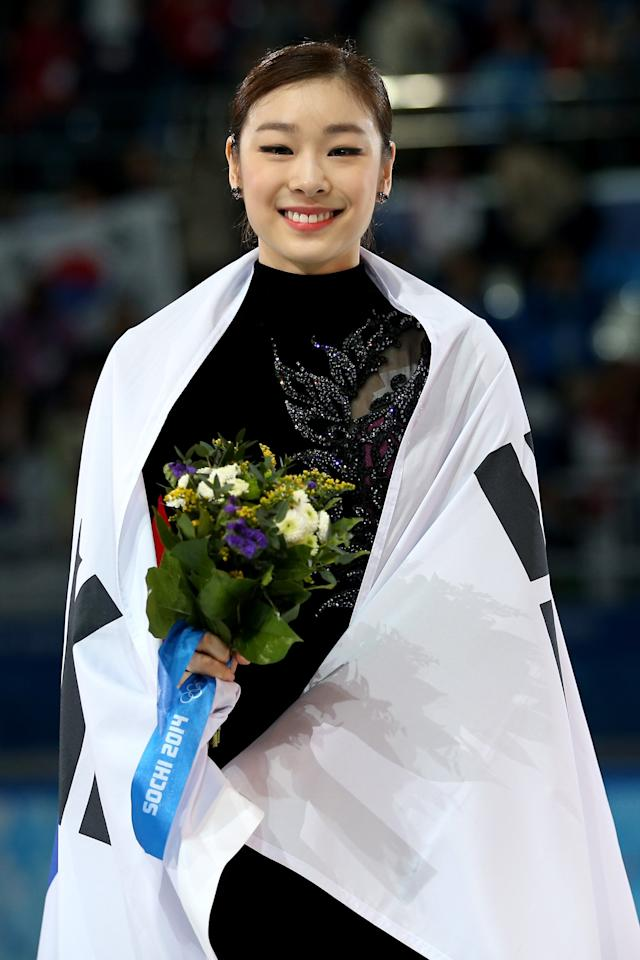 SOCHI, RUSSIA - FEBRUARY 20: Silver medalist Yuna Kim of South Korea celebrates during the flower ceremony for the Ladies' Figure Skating on day 13 of the Sochi 2014 Winter Olympics at Iceberg Skating Palace on February 20, 2014 in Sochi, Russia. (Photo by Matthew Stockman/Getty Images)