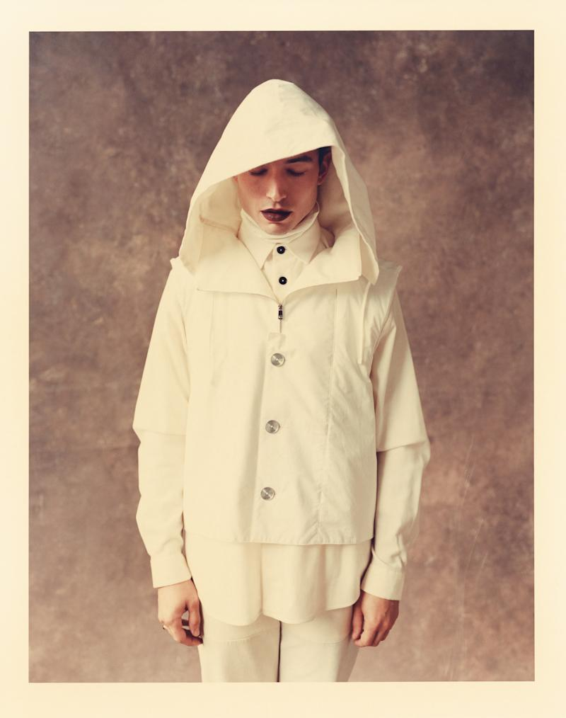 Coat, shirt, turtleneck, and pants, price upon request, by Jil Sander