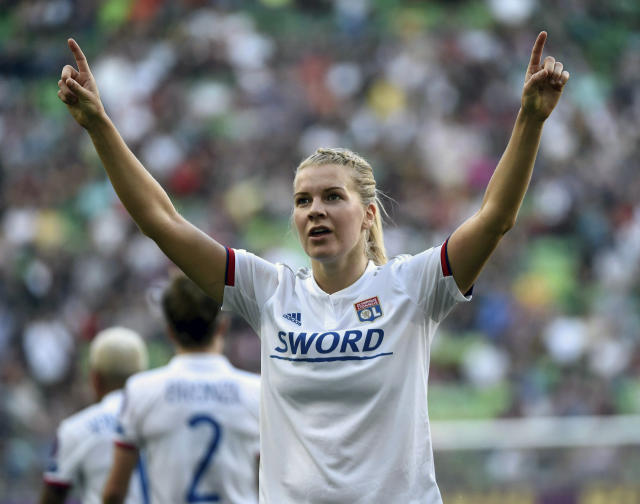 FILE - In this May 18, 2019, file photo, Lyon soccer player Ada Hegerberg, of Norway, celebrates her goal during the women's soccer UEFA Champions League final match against FC Barcelona, in Budapest, Hungary. The world's best player won't be at the Women's World Cup but the world's best team will be, with both sides taking a stand for equality. (Balazs Czagany/MTI via AP, File)