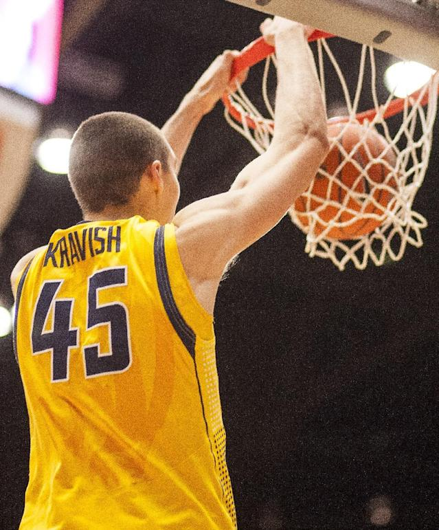 California forward David Kravish (45) dunks against Washington State during the first half of an NCAA college basketball game Wednesday, Feb. 12, 2014, at Beasley Coliseum in Pullman, Wash. (AP Photo/Dean Hare)