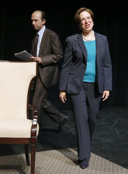 United States Supreme Court Justice Elena Kagan, right, walks on stage with Brown University historian Ted Widmer during a forum at Chase Theater in Providence, R.I., Tuesday, Aug. 20, 2013. (AP Photo/Michael Dwyer)