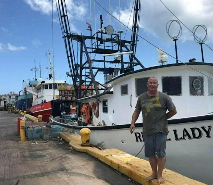 Mike Foy in front of his commercial fishing vessel Rebel Lady. Foy, who is from the Jersey Shore, is in jail in the British Virgin Islands while his family is fighting for his release.