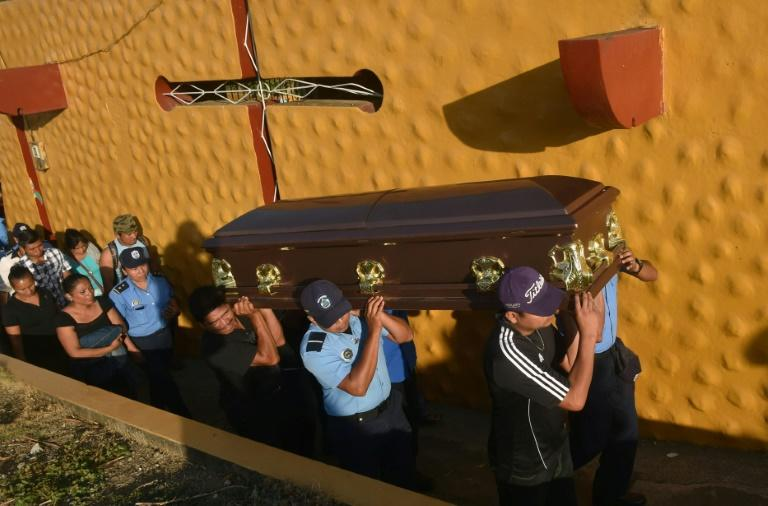Relatives and colleagues of policewoman Juana Francisca Aguilar, who died after being injured during clashes, carry her coffin during her funeral in the city of Jinotepe on April 24, 2018