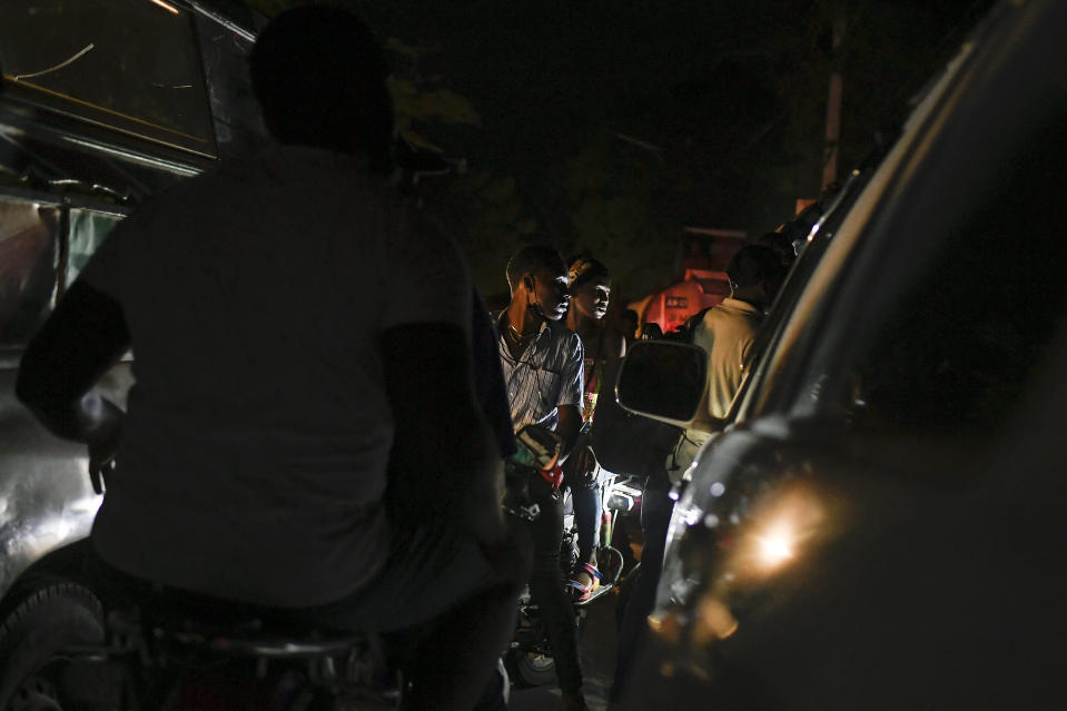 Motorcyclists waits in a long line to fill up their tanks at a gas station amid a fuel shortage in Port-au-Prince, Haiti, late Saturday, July 17, 2021. The country of more than 11 million people are still reeling from the July 7 killing of President Jovenel Moïse. (AP Photo/Matias Delacroix)
