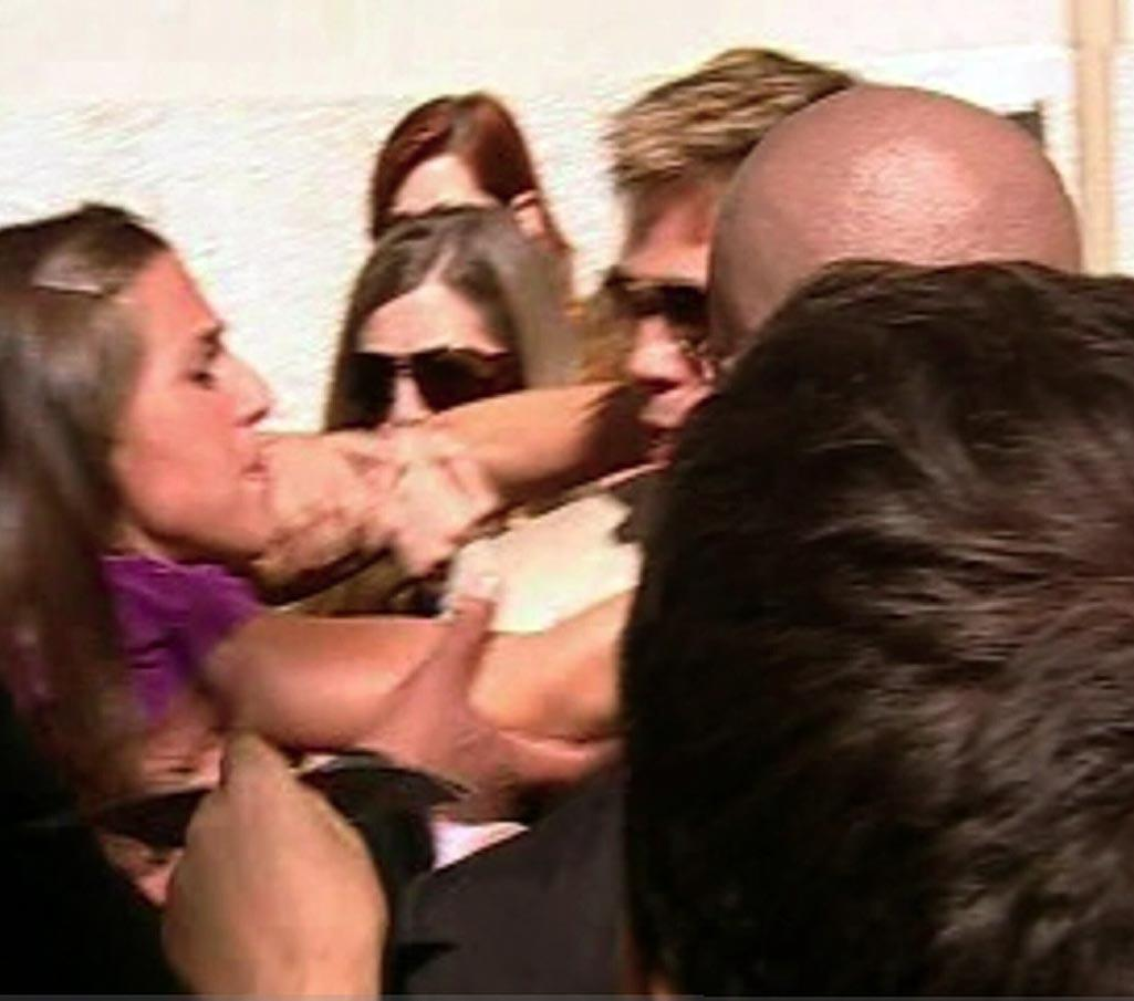 """Fortunately, Brad's security guards were able to quickly detain the young woman. <a href=""""http://www.splashnewsonline.com/"""" target=""""new"""">Splash News</a> - September 3, 2007"""