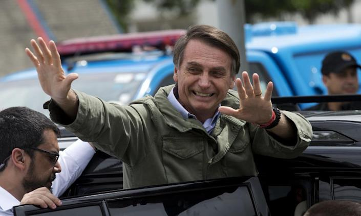 Jair Bolsonaro waves after voting in the presidential runoff election in Rio de Janeiro