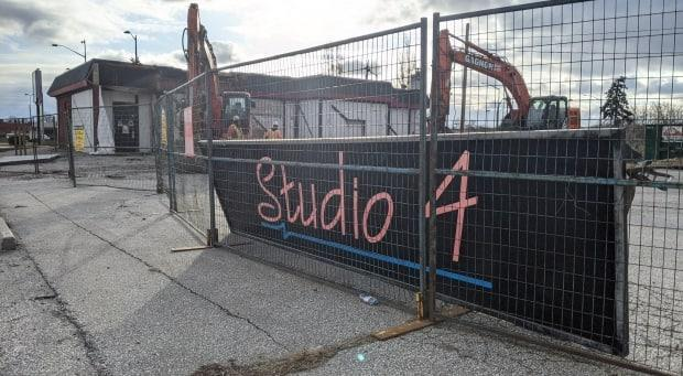 Longtime strip club, Studio 4, is shown being torn down on Thursday, April 1, 2021.  (Sanjay Maru/CBC - image credit)