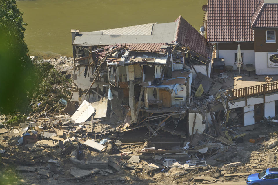 A house is completely torn open after the flood in Marienthal, Germany, Wednesday, July 21, 2021. The flood destroyed numerous houses here as well. (Thomas Frey/dpa via AP)