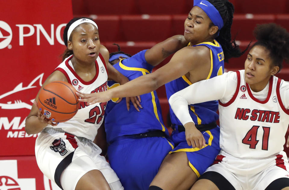 North Carolina State's Kayla Jones (25) pulls the rebound from Pittsburgh's Cynthia Ezeja (14) during the first half of an NCAA college basketball game, Thursday, Feb. 25, 2021 in Raleigh, N.C. (Ethan Hyman/The News & Observer via AP, Pool)