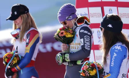 Alpine Skiing - FIS Alpine Skiing World Championships - Women's Giant Slalom - St. Moritz, Switzerland - 16/2/17 - Gold medalist Tessa Worley of France is flanked by silver medalist Mikaela Shiffrin (L) of the USA and Italy's bronze medal winner Sofia Goggia during the flower ceremony.       REUTERS/Denis Balibouse