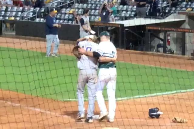 Ty Koehn (R) struck out his friend Jack Kocon (L) to send Koehn's team to the state tournament, but Koehn chose to comfort his friend before he celebrated with his team. (Twitter/@BMTNSports)