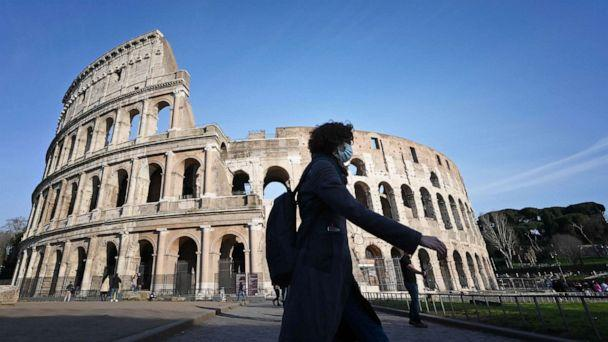 PHOTO: A person wearing a respiratory mask walks past the closed Colosseum monument in Rome, March 10, 2020, as Italy imposed unprecedented national restrictions to control the deadly coronavirus. (Alberto Pizzoli/AFP/Getty Images)