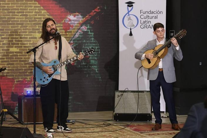2019 Latin Recording Academy Person of the Year recording artist Juanes performs with the winner of Juanes Scholarship, Xavier Cintrón, right, on Tuesday, July 13, 2021, in Miami. .