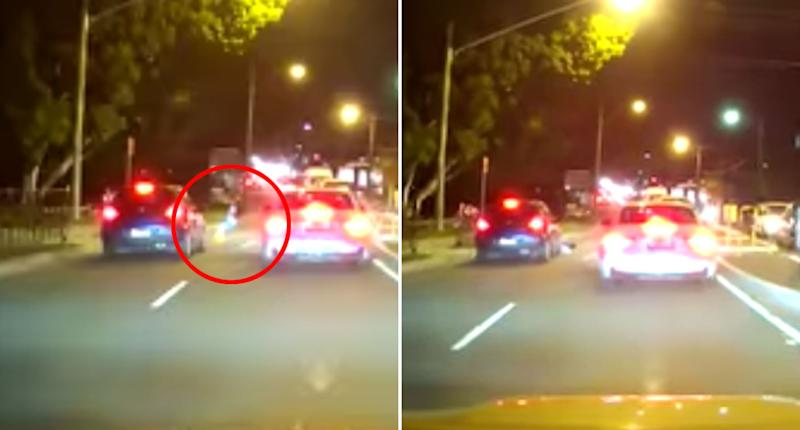 The child seen circled runs in front of a blue hatchback before the car brakes nothing the kid to the ground. A car in the right lane remains stationary suggesting it stopped to let the kid cross.