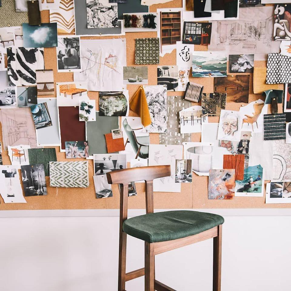 <p>Before there was Pinterest, there were real life mood boards. Take a break from looking at your screen and keep your inspiration right in front of your work station by setting up a large pin board on your walls, like Studio Ashby did here. It'll also double as décor. </p>