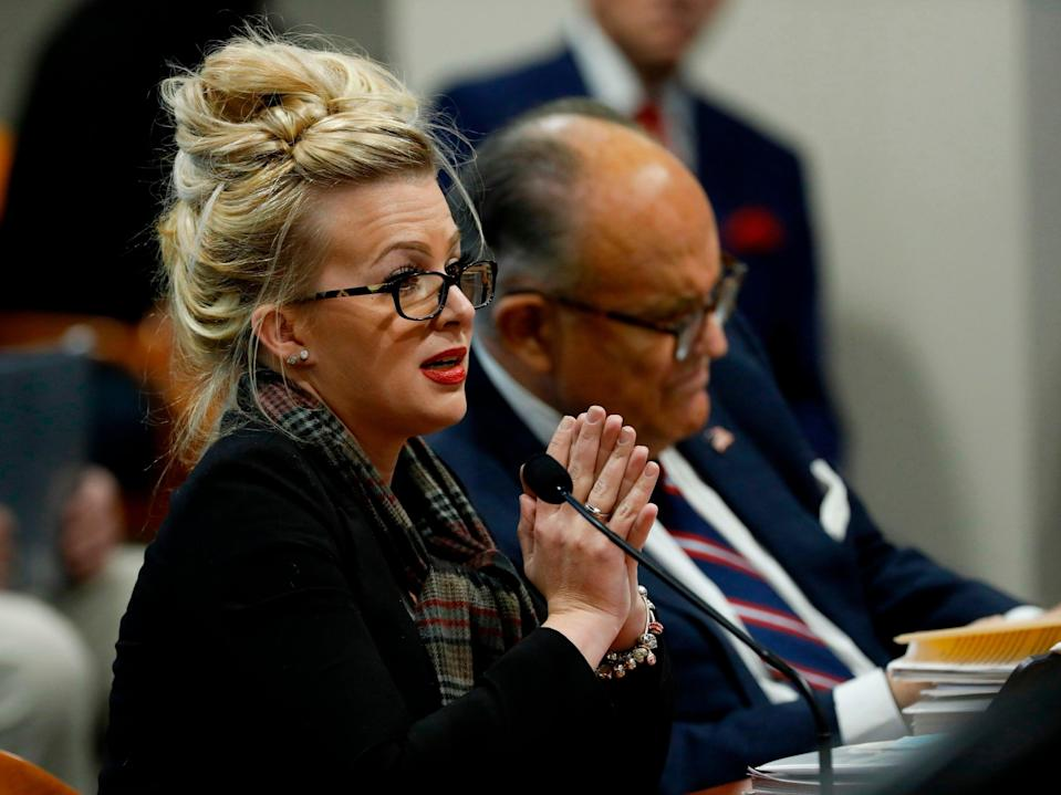 <p>Melissa Carone, who was working for Dominion Voting Services, speaks in front of the Michigan House Oversight Committee in Lansing, Michigan on 2 December 2020</p> ((AFP via Getty Images))