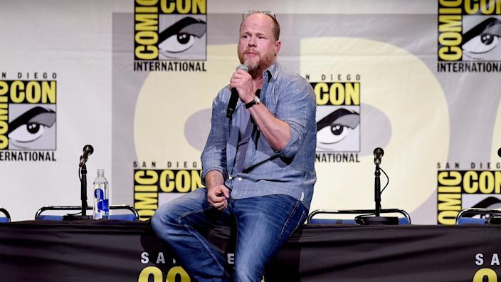 """""""Buffy the Vampire Slayer"""" creator and """"Avengers"""" director Joss Whedon answers questions during a 2016 Comic-Con panel. <span class=""""copyright"""">(Kevin Winter / Getty Images)</span>"""
