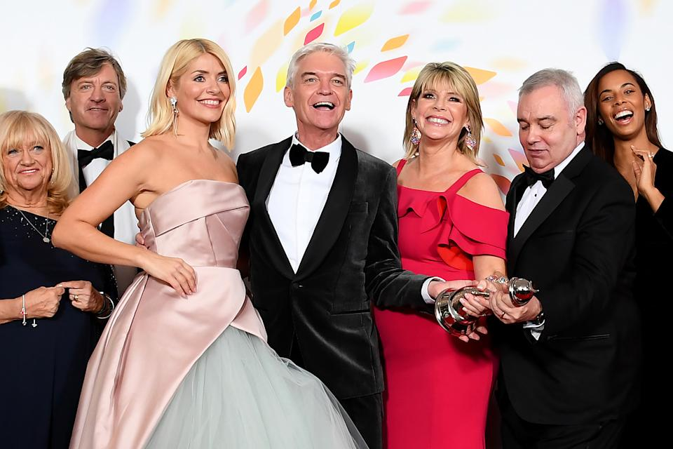 """LONDON, ENGLAND - JANUARY 28: (L-R) Judy Finnigan, Richard Madeley, Holly Willoughby, Phillip Schofield Ruth Langsford, Eamonn Holmes, Rochelle Humes of """"This Morning"""", pose in the winners room after winning the Live Magazine Show award  during the National Television Awards 2020 at The O2 Arena on January 28, 2020 in London, England. (Photo by Gareth Cattermole/Getty Images)"""
