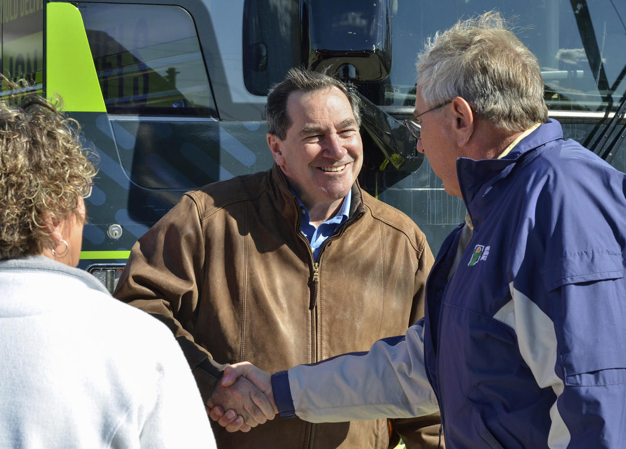 Donnelly, center, talks with a farm couple during a campaign stop in Terre Haute, Ind. (Photo: Austen Leake/Tribune-Star via AP)