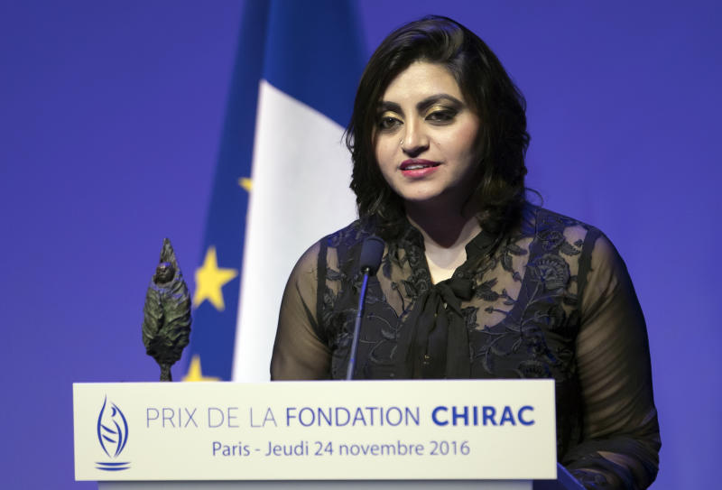 "FILE - In this Nov. 24 2016 file photo, Pakistan's Gulalai Ismail delivers an acceptance speech after being awarded the Prize for Conflict Prevention for the work of her organization 'Aware Girls' promoting women's issues and equality in Pakistan, during the award ceremony of the Jacques Chirac Foundation at the Musee Branly, in Paris, France. On Thursday, Oct. 17, 2019, a dozen plainclothes Pakistani security forces attempted to raid the former home of Ismail, a human rights activist who recently fled to the United States seeking asylum. Ismail's elderly parents say they were ordered to come outside ""just to talk,"" but refused. (Ian Langsdon, Pool via AP, File)"