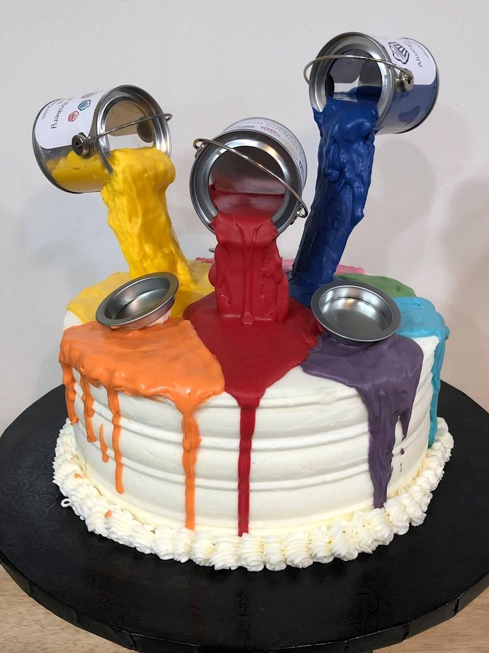 Jay Dawson, baker and co-owner of Always Original Bakery that will open in West Columbia, baked a cake with floating paint cans for an event.