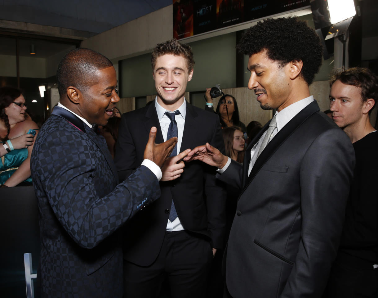"""Stephen Rider, Max Irons and Shawn Carter Peterson arrive at the LA premiere of """"The Host"""" at the ArcLight Hollywood on Tuesday, March 19, 2013 in Los Angeles. (Photo by Todd Williamson/Invision/AP)"""