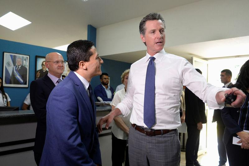 FILE PHOTO: Governor of U.S. state of California Gavin Newsom visits the premises of a migrant assistance office in San Salvador