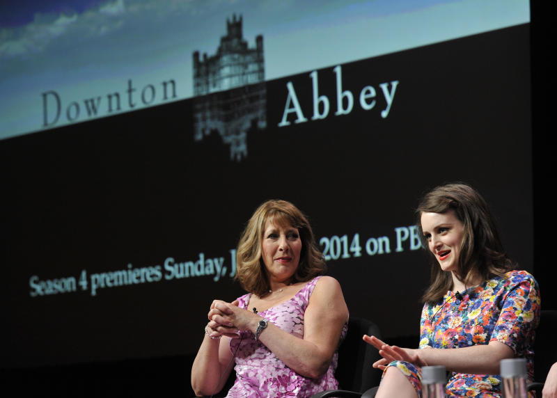 """FILE - This Aug. 6, 2013 file photo shows Sophie McShera, right, and Phyllis Logan, cast members in the Masterpiece series """"Downton Abbey,"""" take part in a panel discussion on the show at the PBS Summer 2013 TCA press tour in Beverly Hills, Calif. (Photo by Chris Pizzello/Invision/AP, File)"""