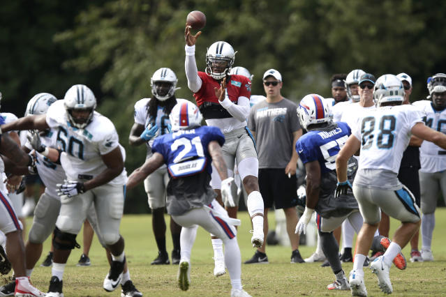 Carolina Panthers quarterback Cam Newton passes against the Buffalo Bills during an NFL football training camp in Spartanburg, S.C., Wednesday, Aug. 14, 2019. (AP Photo/Gerry Broome)