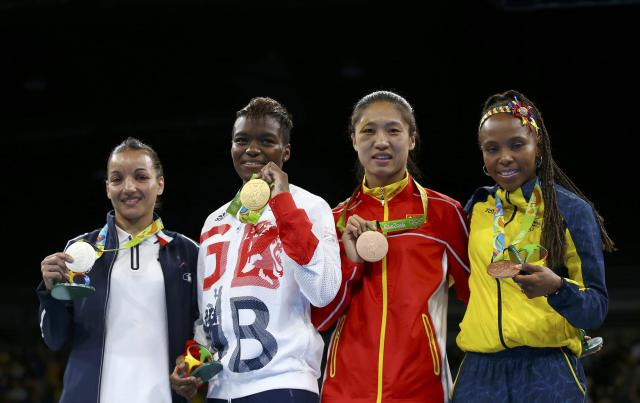 2016 Rio Olympics - Boxing - Victory Ceremony - Women's Fly (51kg) Victory Ceremony - Riocentro - Pavilion 6 - Rio de Janeiro, Brazil - 20/08/2016. (From L) Silver medallist Sarah Ourahmoune (FRA) of France, gold medallist Nicola Adams (GBR) of Britain and bronze medallists Ren Cancan (CHN) of China and Ingrid Valencia (COL) of Colombia pose with their medals. REUTERS/Peter Cziborra FOR EDITORIAL USE ONLY. NOT FOR SALE FOR MARKETING OR ADVERTISING CAMPAIGNS.