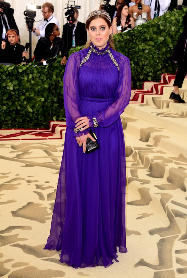 <p>Princess Beatrice surprised royal fans across the globe with her debut appearance at the 2018 Met Gala. The Queen's granddaughter donned a regal purple dress accessorised with a 'heavenly' headpiece. Who needs a tiara when you can have a halo? <em>[Photo: Getty]</em> </p>