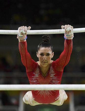 2016 Rio Olympics - Artistic Gymnastics - Final - Women's Individual All-Around Final - Rio Olympic Arena - Rio de Janeiro, Brazil - 11/08/2016. Alexandra Raisman (USA) of USA (Aly Raisman) competes on the uneven bars during the women's individual all-around final. REUTERS/Dylan Martinez/Files